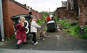 Children play in back alley of Oldham housing estate. - Jess Hurd - ,2000s,2001,back,child,CHILDHOOD,Children,collection,Council Services,Council Services,derelict,DERELICTION,eni,environment,Environmental Issues,EQUALITY,excluded,exclusion,female,females,girl,GIRLS,H