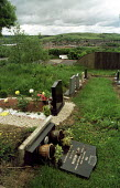 Racists desecrate Muslim graves in Greenacres Cemetery, Oldham the night after 11000 people voted BNP in the General Election and the weekend the NF planned to march. - Jess Hurd - 10-06-2001
