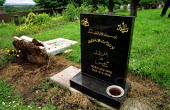 Racists desecrate Muslim graves and overturn head stones in Greenacres Cemetery, Oldham the night after 11000 people voted BNP in the General Election and the weekend the NF planned to march. - Jess Hurd - 10-06-2001
