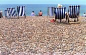 Holidaymakers in deckchairs Brighton Beach. - Jess Hurd - 04-07-2001