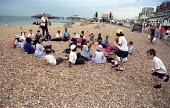 Primary school children from London Borough of Camden play on the beach, supervised by their teachers. Brighton day trip. - Jess Hurd - 04-07-2001
