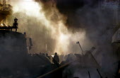 Italian riot police run through burning streets . Genoa G8 summit. - Jess Hurd - 21-07-2001