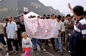 Refugees mainly Afghans, Iraqis, Kurds and Iranians join a protst against their treatment by the authorities, Sangatte Red Cross Refugee camp nr Calais. - Jess Hurd - 02-08-2001