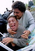 Asylum Seeker Ziyan left Iraq to get medical treatment, unavailable due to sanctions, for her severely disabled son Qodoo, Sangatte Red Cross Refugee camp nr Calais. - Jess Hurd - 07-08-2001