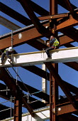 Construction workers balance on steel girder Birmingham Bull Ring building site. - Jess Hurd - 18-10-2001