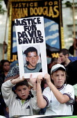 United Families and Friends Campaign march in London to protest at deaths in police custody. David Davies died in Brixton prison 1994 aged 22 - Jess Hurd - 27-10-2001