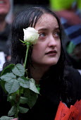 Anti War demonstrators sit down protest Downing Street. Young woman holding a flower - Jess Hurd - 21-10-2001