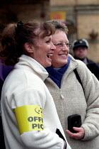 RMT strikers on York Railway Station picket line. Dispute over low pay involving Arriva Northern train conductors. - Jess Hurd - ,2000s,2002,dispute,DISPUTES,EMOTION,EMOTIONAL,EMOTIONS,FEMALE,funny,Humor,HUMOROUS,HUMOUR,INDUSTRIAL DISPUTE,JOKE,JOKES,joking,LAUGH,laughing,LAUGHTER,member,member members,members,network,people,per