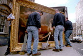 Workers move a valuable painting from the Courtauld Institute. - Jess Hurd - 26-06-2001