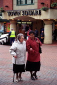 Pensioners laughing and talking walk through Oldham Town Centre, Greater Manchester. - Jess Hurd - 18-06-2001