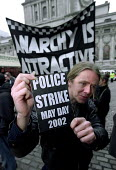 May Day protesters encourage the police to strike May 1st. Police Federation rally. Protest over pay and conditions. - Jess Hurd - 13-03-2002