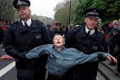 Activists moved from a peaceful sitdown protest by police. Henry Kissinger war criminal protest, London. - Jess Hurd - 24-04-2002