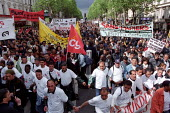 Sans Papiers asylum seekers and French trade unions join anti National Front demonstration through Paris after the shock result for Jean-Marie Le Pen in the Presidential Election. - Jess Hurd - 27-04-2002