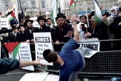Anti Zionist Torah Rabbis are attacked by pro Zionist Jew. Palestinian protest against pro Israel Peace Rally, Trafalgar Square. - Jess Hurd - 06-05-2002