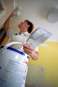 Woman painter and decorator. Leicester City Council Housing Department. - Jess Hurd - 15-05-2002