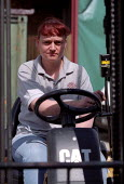 Storeroom manager drives fork lift truck. Leicester City Council Housing Department Training Centre. - Jess Hurd - 15-05-2002