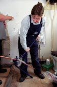 Trainee woman plumber bends copper piping whilst fitting a bathroom for disabled use. Leicester City Council Housing Department. - Jess Hurd - 2000s,2002,apprentice,apprentices,apprenticeship,builder,builders,Construction Industry,Council,disabilities,DISABILITY,disable,disabled,disablement,female,fitting,Housing,incapacity,job,jobs,LAB lbr