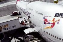 Sky Chef worker loading a Virgin Atlantic Aeroplane, San Francisco International Airport, USA. - Jess Hurd - 28-05-2002