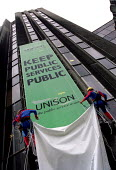 Spiderman and his twin brother unveil Keep Public Sevices Public campaign banner at Unison HQ, London. - Jess Hurd - 10-06-2002