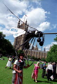 Various companies, such as Nestle feature as huge mosquitos, Trade Justice lobby for Fair Trade, Houses of Parliament, Westminster. - Jess Hurd - 19-06-2002