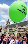 Trade Justice lobby for Fair Trade, Houses of Parliament, Westminster. - Jess Hurd - 2000s,2002,activist,activists,balloon,balloons,CAMPAIGN,campaigner,campaigners,CAMPAIGNING,CAMPAIGNS,DEMONSTRATING,demonstration,DEMONSTRATIONS,Fair,Houses,lobby,Parliament,protest,PROTESTER,PROTESTER