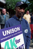 National strike action by members of the TGWU, GMB and UNISON trade unions. Council dispute over low pay. Cambridge Heath Road, Tower Hamlets, London. - Jess Hurd - ,2000s,2002,black,BME black,caretaker,CARETAKERS,Council,DISPUTE,DISPUTES,ethnic,ETHNICITY,highway,INDUSTRIAL DISPUTE,line,local authority,member,member members,members,minority,multiracial multiracia