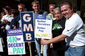 National strike action by members of the TGWU, GMB and UNISON trade unions. Council dispute over low pay. Cambridge Heath Road, Tower Hamlets, London. - Jess Hurd - ,2000s,2002,Council,DISPUTE,DISPUTES,highway,INDUSTRIAL DISPUTE,line,local authority,member,member members,members,people,picket,PICKETING,PICKETS,Road,ROADS,strike,striker,STRIKERS,strikes,striking,T