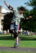 Skateboarding for beginners, Urban Games, Clapham Common, London. - Jess Hurd - 2000s,2002,board,boarding,EXTREME,fall,falling,female,Games,lfl Leisure,off,people,person,persons,Skate,Skateboard,Skateboarding,SKATEBOARDS,SPO sport,SPORTS,UK,Urban,woman,women
