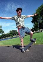 Skateboarding for beginners, Urban Games, Clapham Common, London. - Jess Hurd - 2000s,2002,board,boarding,EXTREME,female,Games,lfl Leisure,people,person,persons,Skate,Skateboard,Skateboarding,SKATEBOARDS,SPO sport,SPORTS,UK,Urban,woman,women