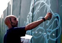 Graffiti artist, Urban Games, Clapham Common, London. - Jess Hurd - 26-07-2002