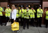 Police guard shop entrance as Pro Palestinian protesters attempt to occupy Selfridges in response to the store stocking goods made in Israeli settlements. Oxford Street, London. - Jess Hurd - 03-08-2002
