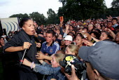 Ms Dynamite with the crowds at the Love Music Hate Racism Anti Nazi League carnival in Manchester. - Jess Hurd - ,2000s,2002,ACE arts culture & entertainment,activist,activists,anl,Anti Racism,BAME,BAMEs,bigotry,black,BME,bmes,CAMPAIGN,campaigner,campaigners,CAMPAIGNING,CAMPAIGNS,cultural,dance,DANCER,DANCERS,da