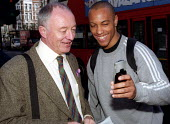 A passer by takes a photograph of himself with Ken Livingstone on his mobile phone with integrated digital camera. City workers in trade union campaign to Organise the City, raising awareness of emplo... - Jess Hurd - 2000s,2002,BAME,BAMEs,Black,BME,bmes,call,campaign,campaigning,CAMPAIGNS,celebrity,CELLULAR,communicating,communication,digital,diversity,email,employment,ethnic,ethnicity,london,mayor,MAYORAL,MAYORS,