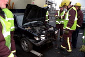 East London firefighters attend a Road Traffic Accident on the A406 where a car crashed into a barrier, London. - Jess Hurd - 31-10-2002