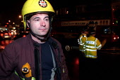 Firefighters attend a suspect package call alongside the police and bomb disposal experts, Leyton, London. - Jess Hurd - 30-10-2002