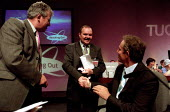 Tony Blair shakes the hand of Jim McDougall awarded with the TUC Gold Badge. TUC Conference 2002, Blackpool. - Jess Hurd - 2000s,2002,Conference,conferences,congress,Gold,member,member members,members,people,POL Politics,Trade Union,Trade Union,trade unions,Trades Union,Trades Union,trades unions,TUC,UK,Unison,worker,work