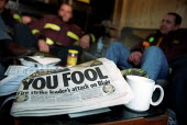 You Fool - The Mirror front page attack on Blair. Red watch, in their makeshift strike shelter. Eight day strike in a dispute over pay, Bow, East London. - Jess Hurd - 2000s,2002,adult,adults,attack,attacking,dispute,DISPUTES,FBU,fire brigade,firefighter,FIREFIGHTERS,firefighters strike,firefighters' strike,fireman,firemen,hardline,headline,headlines,INDUSTRIAL DISP