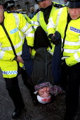 Protester is arrested at Warzone Whitehall Action, nonviolent die-in against war and sanctions on Iraq.Whitehall Place, Whitehall. Organised by Voices in the Wilderness. - Jess Hurd - 02-12-2002