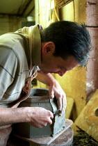 Potter trims chimney stack, Redbank Manufacturing, Measham, Staffordshire - Jess Hurd - 2000s,2002,capitalism,capitalist,ce,ceramic,CERAMICS,chimney,CHIMNEYS,clay,clayware,craft,earthenware,EBF,EBF economy,Economic,Economy,Industries,industry,job,jobs,LAB lbr Work,maker,makers,making,man