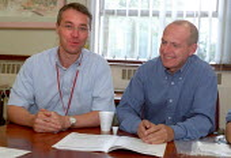 TGWU Senior shop steward - Glenn Ford Plant Manager Ian Wagstaff. Union / management meeting. 3M Sandpaper, Atherstone, Warwickshire. - Jess Hurd - 09-07-2002