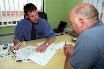 TGWU senior shop steward Keith Jones with Tim Barnett Group Production Director. Redbank Manufacturing, Measham, Staffordshire - Jess Hurd - 09-07-2002