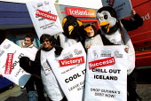 Penguin campaigners join a victory protest at Iceland South London. The food store has agreed to Drop Guyanan Debt. Organised in by WDM, Jubilee Debt Campaign and Drop the Debt. - Jess Hurd - 2000s,2003,3rd,activist,activists,CAMPAIGN,campaigner,campaigners,CAMPAIGNING,CAMPAIGNS,debt,DEMONSTRATING,DEMONSTRATION,DEMONSTRATIONS,food,FOODS,Guyana,Iceland,protest,PROTESTER,PROTESTERS,protestin