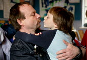 A father kisses his son goodbye at a nursery. - Jess Hurd - 2000s,2003,boy,BOYS,CARE,carer,carers,child,Child Care,childcare,CHILD-CARE,childhood,CHILDMINDING,children,CRECH,creche,creches,DAD,DADDIES,daddy,DADS,day care,daycare,EARLY,early years,EDU education