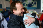 A father hugs his son goodbye at a nursery. - Jess Hurd - 2000s,2003,boy,BOYS,CARE,carer,carers,child,Child Care,childcare,CHILD-CARE,childhood,CHILDMINDING,children,CRECH,creche,creches,DAD,DADDIES,daddy,DADS,day care,daycare,EARLY,early years,EDU education