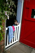 Son waves goodbye to his father from behind his nursery gate. - Jess Hurd - 2000s,2003,adult,adults,boy,BOYS,CARE,carer,carers,child,Child Care,childcare,CHILD-CARE,childhood,CHILDMINDING,children,CRECH,creche,creches,DAD,DADDIES,daddy,DADS,day care,daycare,EARLY,early years,