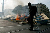 Protesters stand with a burning barricade at anti G8 Summit protests in Geneva, Switzerland. - Jess Hurd - 01-06-2003