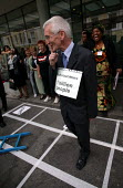 Delegates to the TUC's Gender and Globalisation conference take part in a Giant 'unfair trade rules' snakes and ladders game, with rich countries fixed to win with the help of the WTO. Series of '24 h... - Jess Hurd - 2000s,2003,activist,activists,anti capitalism,campaign,campaigner,campaigners,campaigning,CAMPAIGNS,capitalism,capitalist,conference,conferences,country,DELEGATE,Delegates,DEMONSTRATING,demonstration,