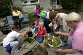 Year 3 children from Langley Junior School take part in gardening activities with volunteer Rose Perkis, ex Meal Time Assistant (who was pensioned at 60). Part of the Government Pathfinder project, pi... - Jess Hurd - 02-07-2003