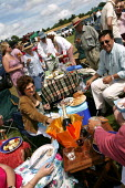The wealthy enjoy a picnic at The Veuve Clicquot Gold Cup Polo Final, Cowdray Park Polo Club. West Sussex. - Jess Hurd - 20-07-2003