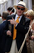 The wealthy enjoy a drink at The Veuve Clicquot Gold Cup Polo Final, Cowdray Park Polo Club. West Sussex. - Jess Hurd - 2000s,2003,ACE culture,AFFLUENCE,AFFLUENT,alcohol,Bourgeoisie,Champagne,CHAMPAIGN,class,club,clubs,drink,drinker,drinkers,drinking,drinks,elite,elitism,EQUALITY,glass,glasses,Gold,high,high income,inc